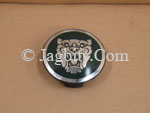 WHEEL EMBLEM BADGE FOR CENTER OF WHEEL SILVER HEAD GREEN BACKGROUND C2C30080